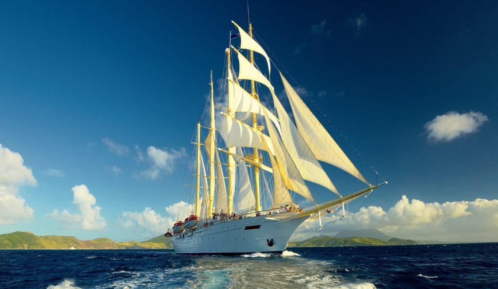 Segelurlaub Europa STAR FLYER Produktbild zeigt den 4 Mast Großsegler als Bugansicht unter Segeln